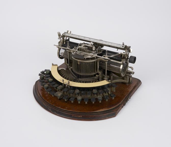 Hammond typewriter with 2-row curved keyboard and braille strip, c. 1904