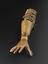 Right below elbow prosthesis, made for a lady pianist.  Blocked leather socket connected by jointed side steels to a