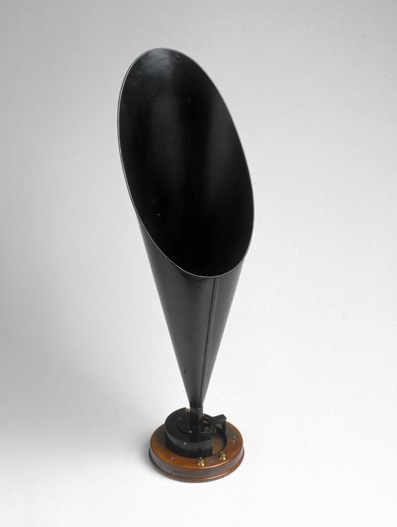 Straight horn loudspeaker made by S. G. Brown Ltd., 1921. Oblique front view of whole object on graduated grey