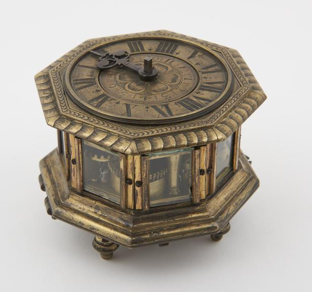 5 brass octagonal table clock with glass sides, verge escapement, inscribed 'David Weber.  Aug.''
