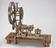Rose engine lathe belonging to Lord Macclesfield, c1740. General front three quarter view. Light grey background with