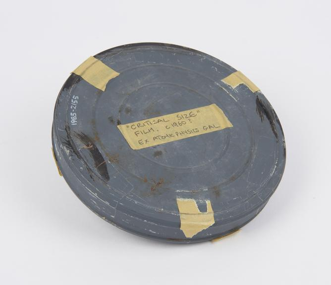 Roll of cinematic film in metal can of the film ?Critical Size?, British, c. 1960.