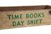 Empty rectangular wooden box, cream, with 'Bickershaw' / Time books day shift' painted in green.