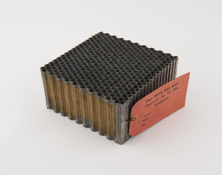 Block of film car radiator tubes, on a wooden stand, shared with Inv.1930-3.