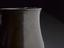 """Syphon or """"Tantalus"""" cup. Syphon or 'tantalus' cup. The small copper vessel has a handle made from a piece of hollow"""