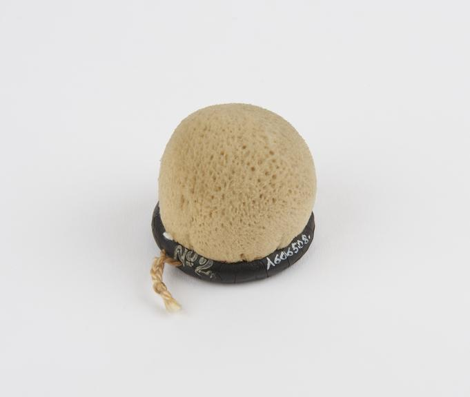 Cervical cap, rubber covered with sponge, the Improved Gem', patented in 1929'