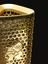 London 2012 Olympic Torch, designed by BarberOsgerby, London, England, 2012,  logo detail, black background, vertical