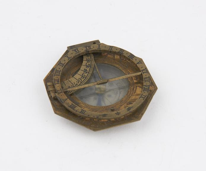 Octagonal shaped sundial, brass, inscribed Schreteger', 2-in. diameter, Johann Schretteger, Augsburg, Germany,