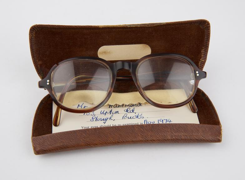 One pair of bifocal spectacles Nationals Health Service spectacles, with lens cloth, and optician's advice note, in