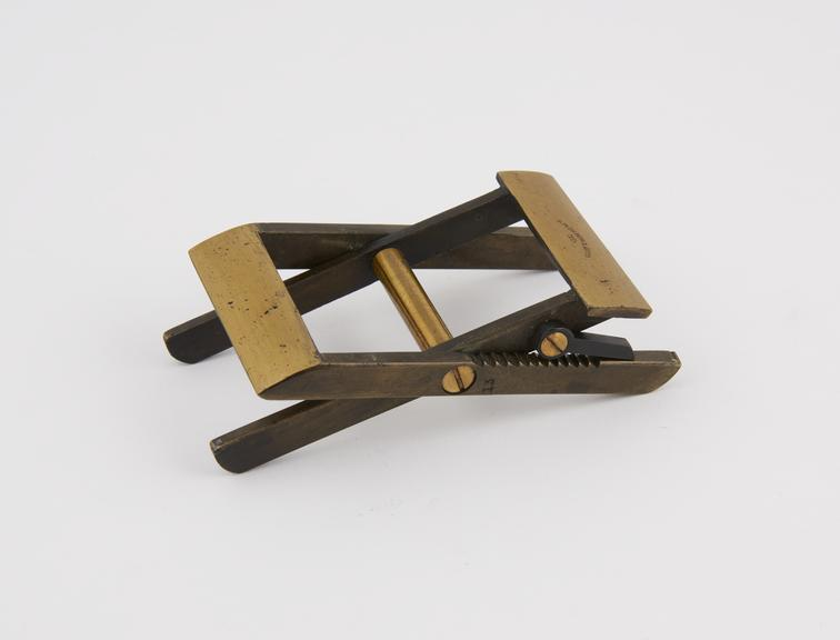 Adjustable saw buck' folding packet folder, brass, by S. Maw, Son and Sons Ltd., England,  1850-1900'