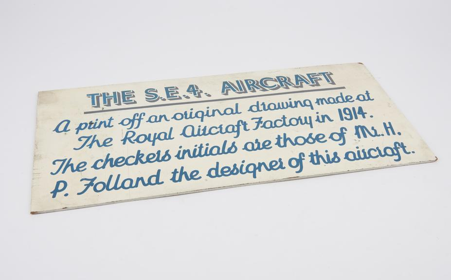 Wooden hand sign written placard entitled The S.E.4 Aircraft'. A print of an original drawing made at The Royal