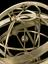 Ptolemaic armillary sphere. Detail view, black background.