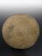 Divination plate. Disc-like brass divination plaque engraved with signs of zodiac and Islamic script, from Middle East,