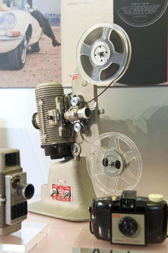 Bell & Howell model 606 8mm cine projector. Side oblique view. Gallery display.