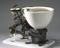 """""""Optimus"""" patent water closet of 1870. Image taken 3/4 view with graduated grey background."""