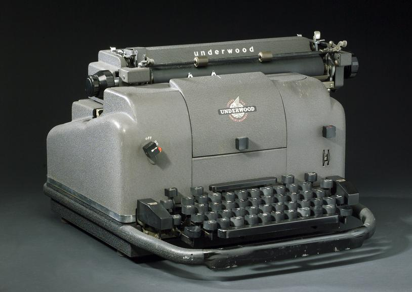 Underwood electric typewriter, c. 1950. General three quarter view. Graduated black background