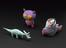 Three 3D printed 'Crayon Creature' models, made from childrens drawings digitally rendered into 3D, by Crayon