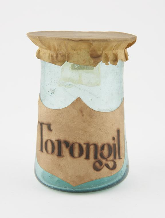 Glass drug jar, with parchment cover, inscribed Torongil', possibly Spanish, 18th century'