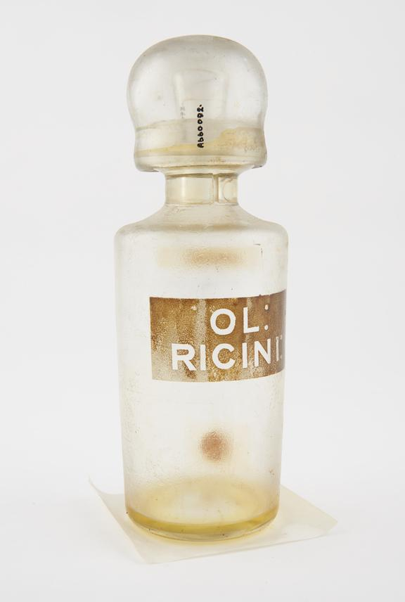 Clear glass shop round, labelled OL:RICINI:', British'