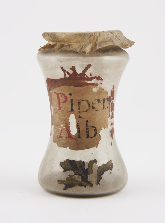 Glass albarello, with parchment cover, labelled Piper Alb' (white pepper), Spanish,17th or 18th century'