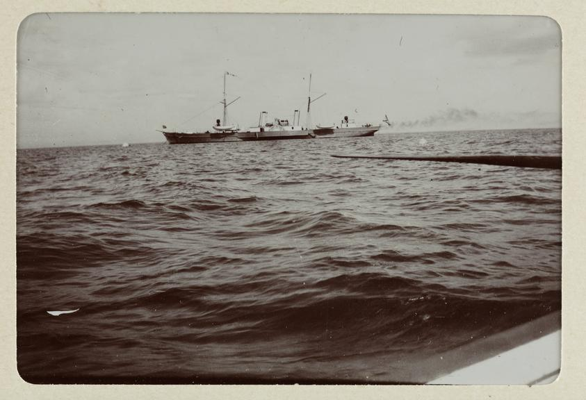 Black and white photograph entitled 'Peterhof, the Guard-Ship', showing a view of a ship at sea, taken by Herbert