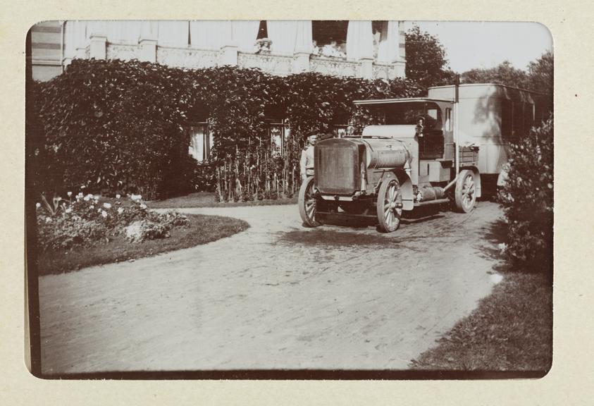 Black and white photograph entitled 'Peterhof, Motor Train waiting outside Alexandrie', taken by Herbert Stewart in St
