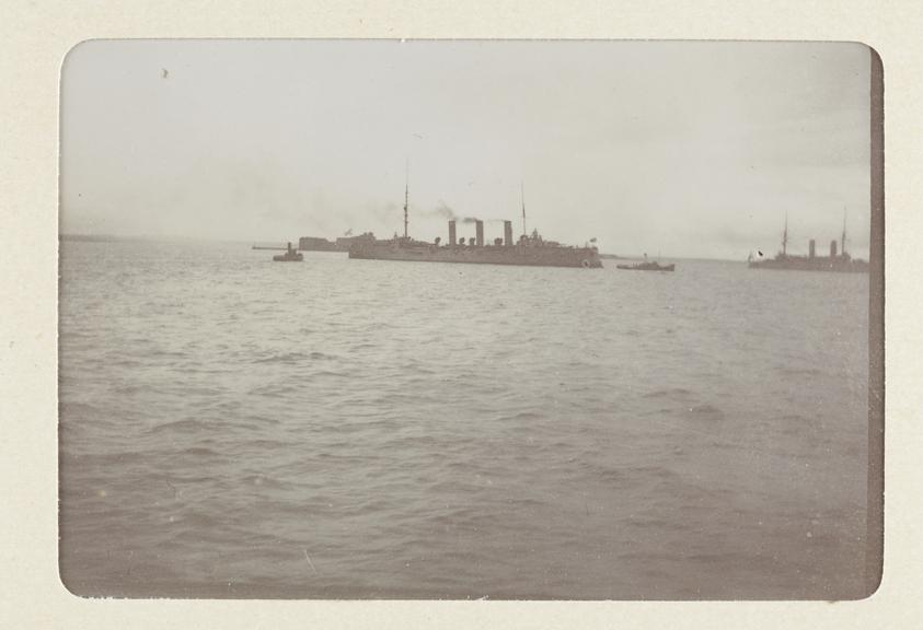 Black and white photograph entitled 'Some of the Russian Fleet off Cronstadt - Bogatyr' taken by Herbert Stewart in