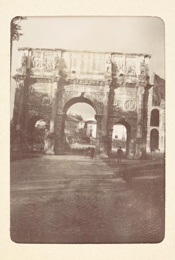 Black and white photograph entitled 'Rome',showing a view of the triumphal arch. Taken by Herbert Stewart in Rome,