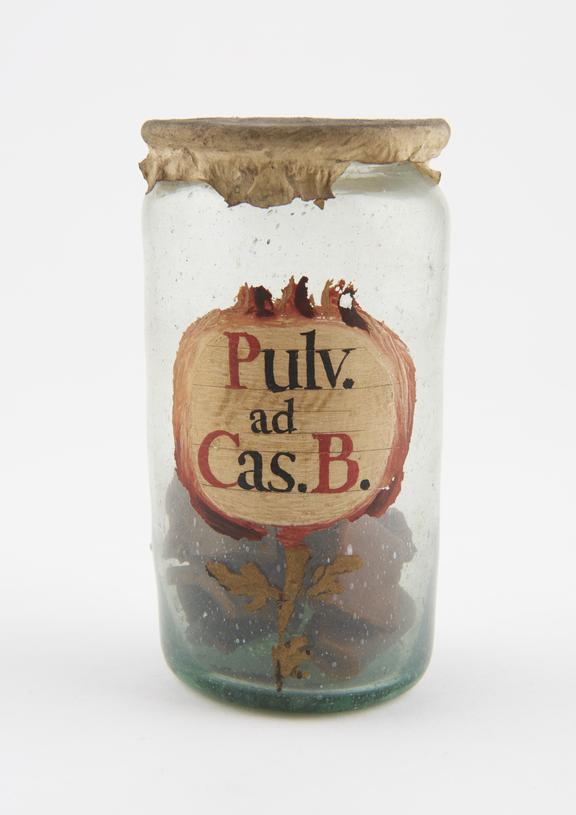 Glass drug jar, labelled PULV.AD.CAS.B' and 'GOMA ELASTICA', probably Spanish, 17th or 18th century'