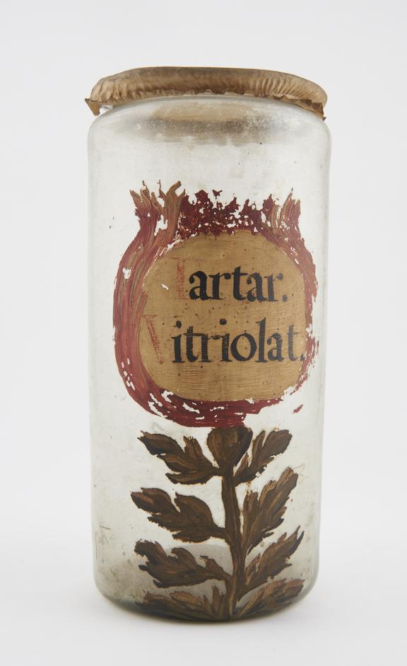 Glass drug jar, with parchment lid, labelled, TARTAR VITRIOLAT' (Vitriolated tartar in potassium sulphide), probably
