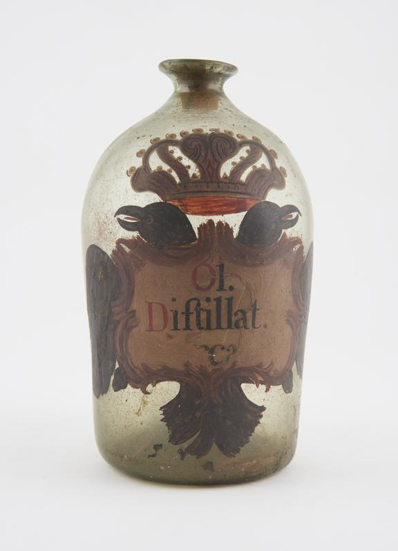 Glass bottle, labelled OL DISTILLAT...' (Distilled oil) and 'FINTURA DE NARAJAS' (tincture of orange), painted with