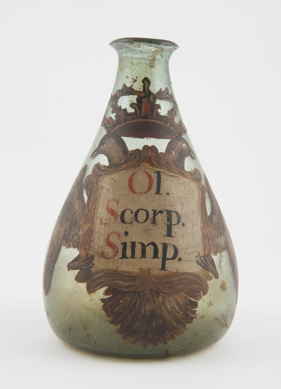 Glass flask, conical, labelled OL SCORP SIMP' painted with monastic arms, Spanish, 17th or 18th century. Simple oil of
