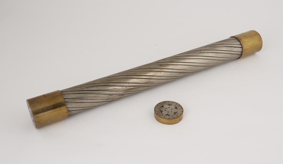 Sample of 5 1/2 circular locked colliery guide rope half lock. No.3023 and cross section'