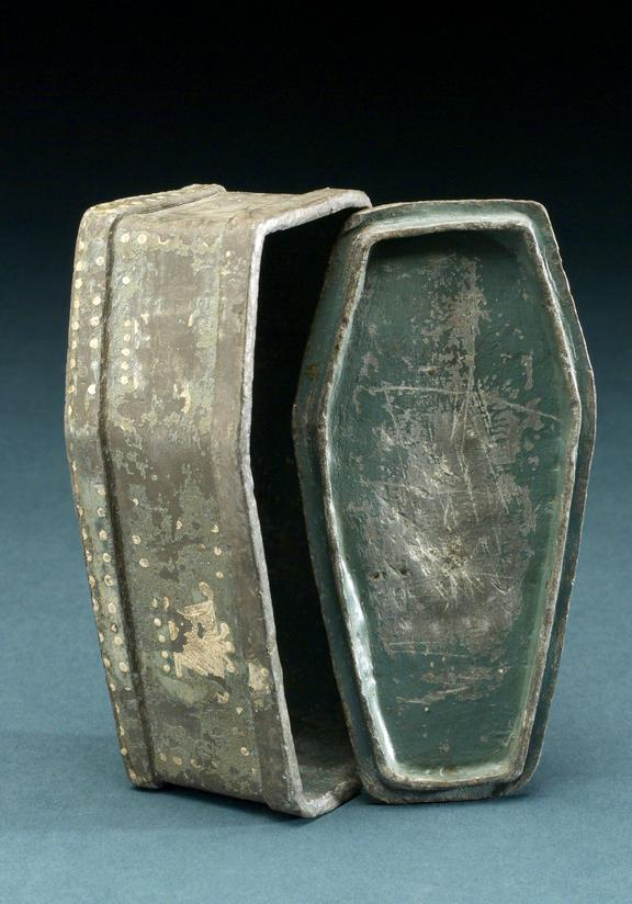 Coffin shaped lead Tabacco Jar, with painted green interior. English, 1790-1830. Image of lid resting on upright jar.