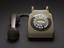 746 telephone, grey. Whole object. Front view. Grey background.