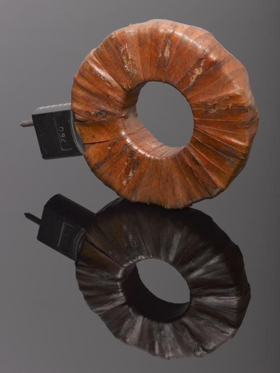 Burndept plug-in inductance coil No. 750. One object. Front view. Black background.