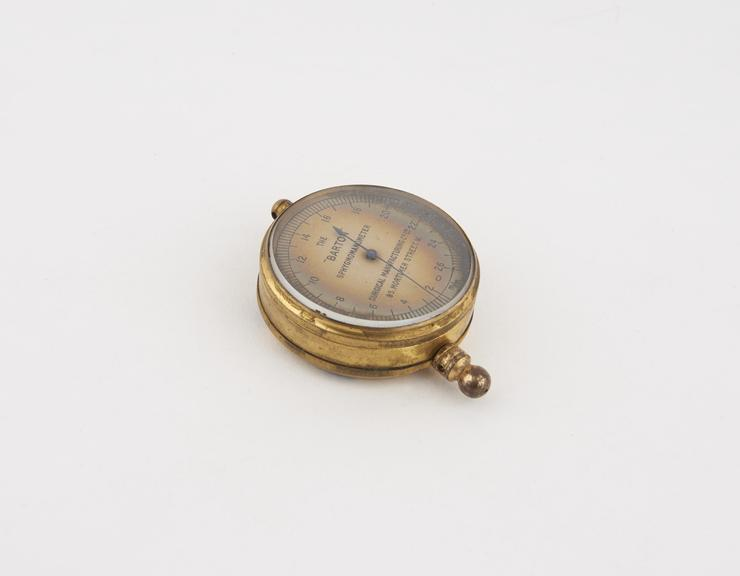 Aneroid manometer, from sphygmomanometer, by Surgical Manufacturing Co. Ltd., 85 Mortimer Street, London, W, England.