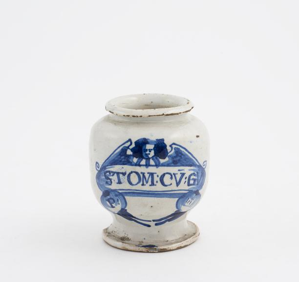 Tin-glazed earthenware drug jar, inscribed P:STOM:CV:GV' decorated with angel motif, English, possibly 1690-1700'