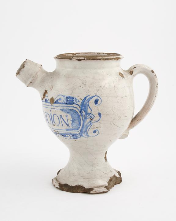 Tin-glazed earthenware syrup jar, inscrubed DIACODION', decorated with 'pipe smoking man'  design, English, 1650-1670'