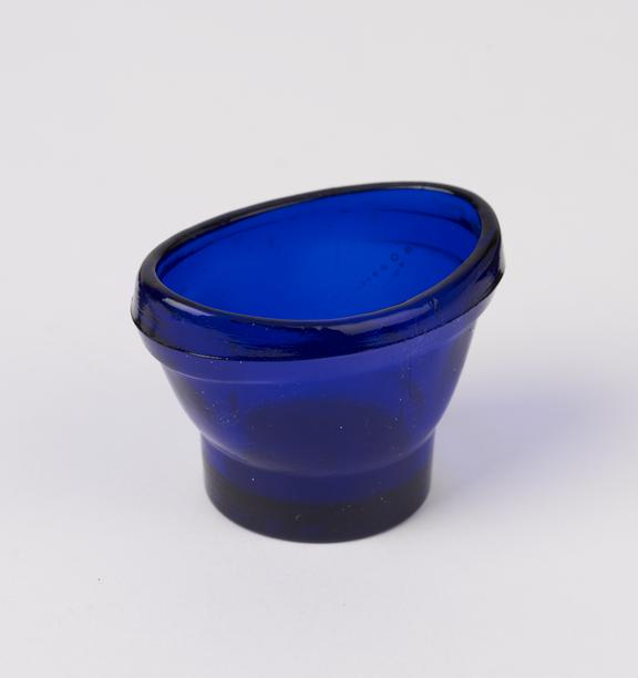 Glass eye bath, blue, for use with Optrex', English, 20th century'