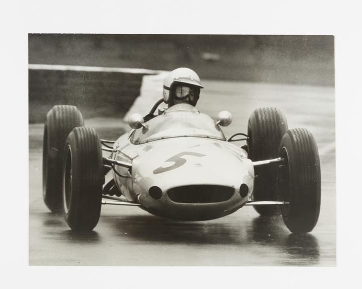 Andor Kraszna Krausz Collection. Silver gelatin photograph by Gerry Cranham. Image shows an unidentified driver on a