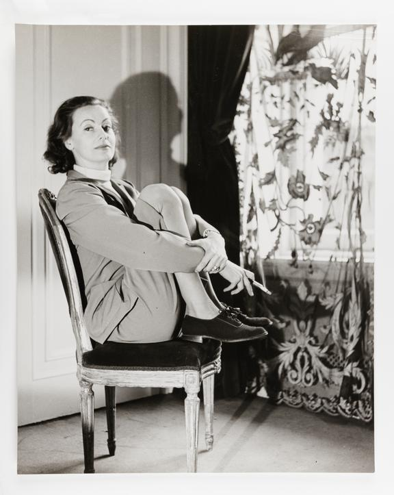 Kodak Collection. Oversize bromide photograph by Cecil Beaton. Portrait of film star Greta Garbo sitting in chair and