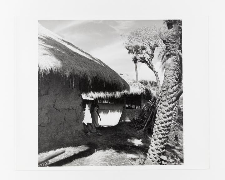 Andor Kraszna Krausz Collection. Silver gelatin copy print made ca.1970s. Photograph by Sir Cecil Beaton of thatched