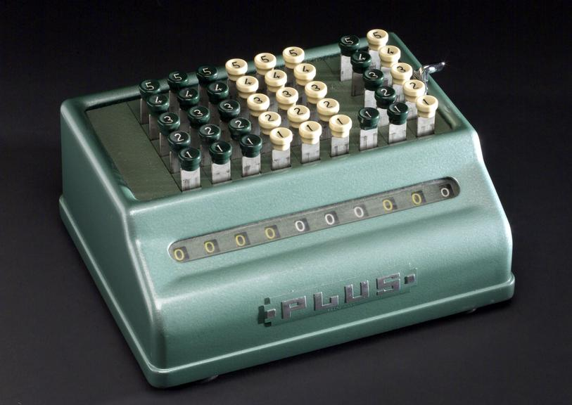 One of a collection of three mechanical hand calculators.