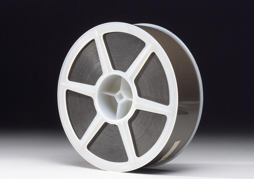 Piece of bubble chamber film, 70mm format.       Bubble Chamber Film: Five lengths, each of a different type: one 700mm from