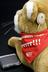 """'Clarion"""" Cougar' soft toy with cochlear implant, by Advanced Bionics UK Ltd., 1999.       Detail view of hearing aid behind"""