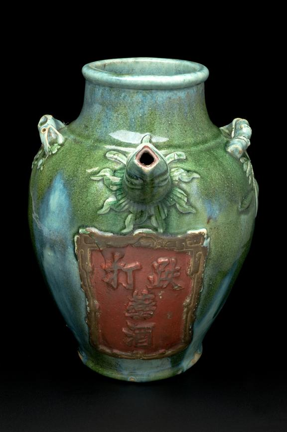 Earthenware pharmacy jar, glazed, Chinese, Ching dynasty (1644-1911)       Full view, black background.