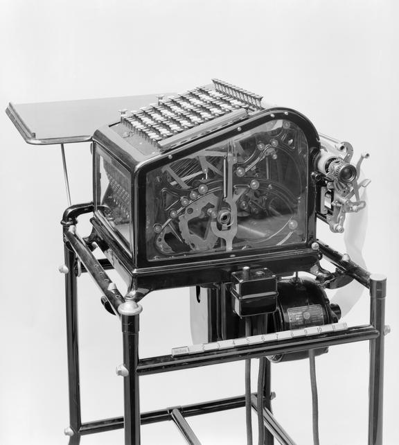 """Copy of 12"""" x 10"""" bromide print of Burrough's adding and listing machine (motor driven). Black & white photograph from"""