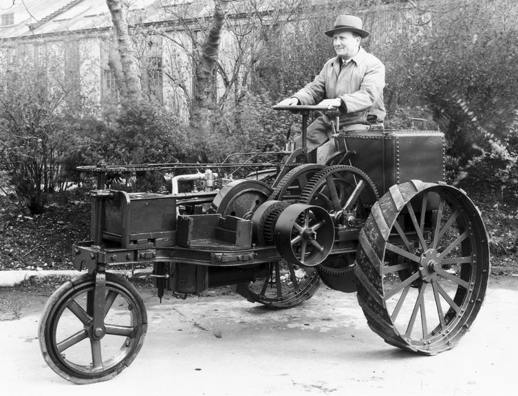 Ivel 3 wheeled tractor - with driver.       Ivel agricultural tractor on three steel wheels (front single, with solid rubber