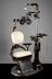 Hydaulic chair and column, with stool, accessories include Green's refractor, by Bausch and Lomb of USA, c. 1930.       Full